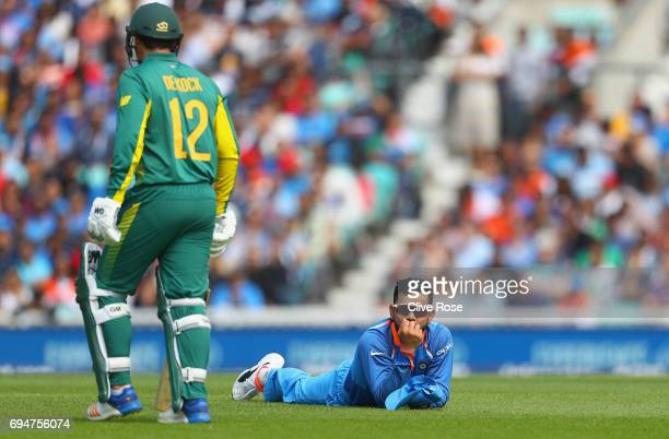 Virat Kohli of India looks on after narrowly failing to run out Quinton de Kock of South Africa during the ICC Champions trophy cricket match between...