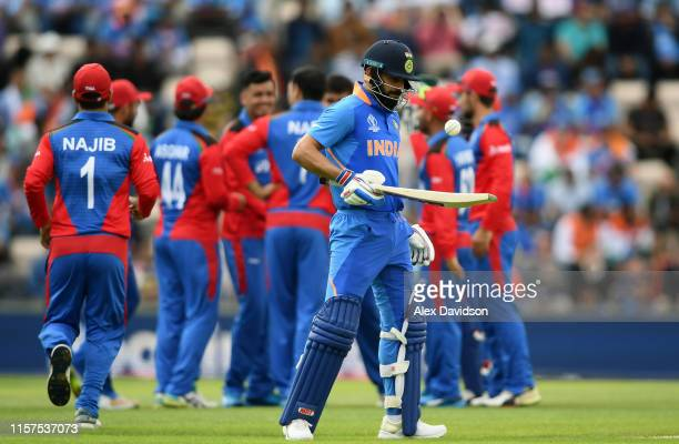 Virat Kohli of India looks on as Afghanistan celebrate the wicket of KL Rahul during the Group Stage match of the ICC Cricket World Cup 2019 between...