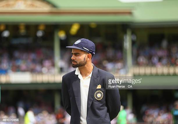 Virat Kohli of India looks on at the coin toss during day one of the Fourth Test match between Australia and India at Sydney Cricket Ground on...