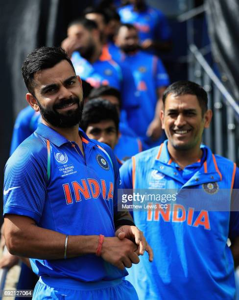 Virat Kohli of India looks on with MS Dhoni ahead of the ICC CHampions Trophy match between India and Pakistan at Edgbaston on June 4 2017 in...