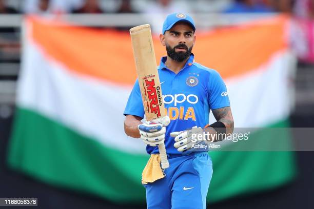 Virat Kohli of India looks up at the scoreboard during the third MyTeam11 ODI between the West Indies and India at the Queen's Park Oval on August...