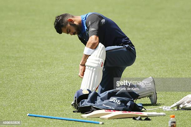 Virat Kohli of India pads up during an India training session at Adelaide Oval on November 29 2014 in Adelaide Australia