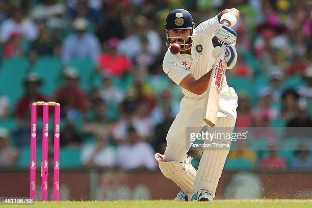 Virat Kohli of India plays a cover drive during day four of the Fourth Test match between Australia and India at Sydney Cricket Ground on January 9...