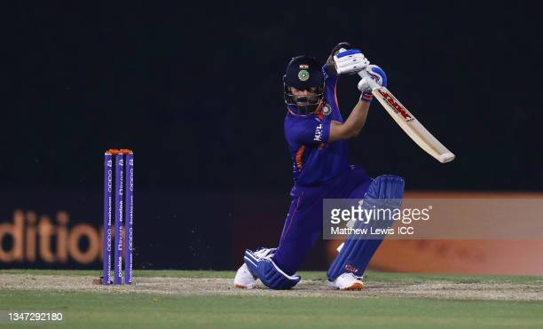 Virat Kohli of India plays a shot during the India and England warm Up Match prior to the ICC Men's T20 World Cup at on October 18, 2021 in Dubai,...