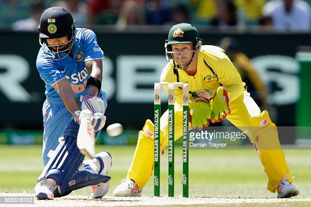 Virat Kohli of India plays a sweep shot during game three of the One Day International Series between Australia and India at Melbourne Cricket Ground...