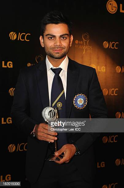 Virat Kohli of India poses for the camera with his ICC ODI Player of the Year award during the LG ICC Awards at the Waters Edge Resort on September...