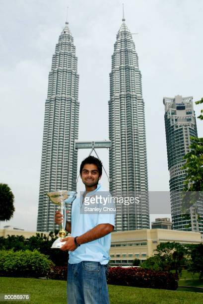 Virat Kohli of India poses with the ICC U19 Cricket World Cup at the Kuala Lumpur Twin Towers on March 3, 2008 in Kuala Lumpur, Malaysia.