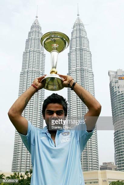 Virat Kohli of India poses with the ICC U19 Cricket World Cup at the Kuala Lumpur Twin Towers on March 3 2008 in Kuala Lumpur Malaysia