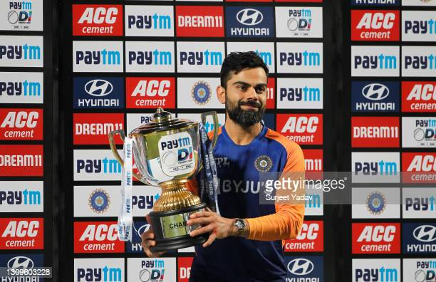 Virat Kohli of India poses with the trophy after winning the ODI series following the 3rd One Day International match between India and England at...