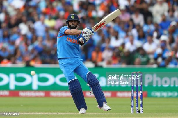 Virat Kohli of India pulls a delivery to the legside boundary during the ICC Champions Trophy SemiFinal match between Bangladesh and India at...
