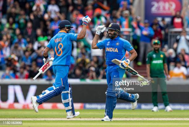 Virat Kohli of India punches the air as team mate Rohit Sharma reaches his century during the Group Stage match of the ICC Cricket World Cup 2019...