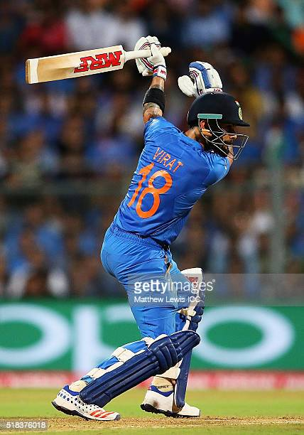 Virat Kohli of India pushes the ball towards the boundary during the ICC World Twenty20 India 2016 SemiFinal match between West Indies and India at...