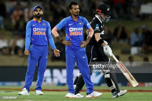 Virat Kohli of India questions Yuzvendra Chahal of India during game three of the One Day International Series between New Zealand and India at Bay...