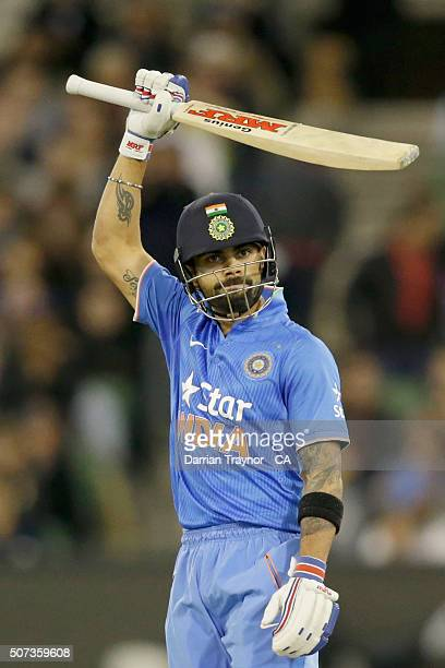 Virat Kohli of India raises his bat after scoring 50 runs during the International Twenty20 match between Australia and India at Melbourne Cricket...