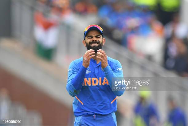 Virat Kohli of India reacts after missing a run out chance during the Semi-Final match of the ICC Cricket World Cup 2019 between India and New...
