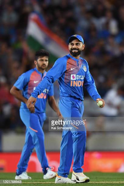Virat Kohli of India reacts after taking a catch to dismiss Kane Williamson of New Zealand during game one of the Twenty20 series between New Zealand...