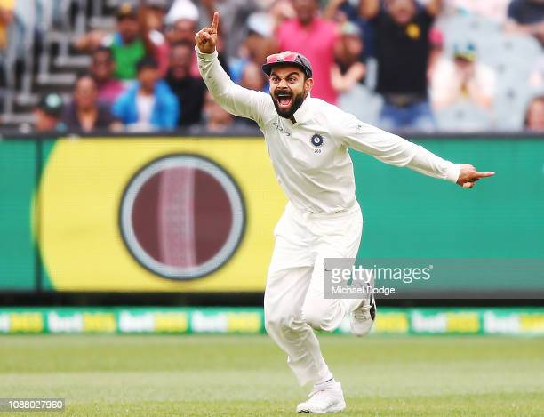 Virat Kohli of India reacts after the dismissal of Pat Cummins of Australia during day five of the Third Test match in the series between Australia...