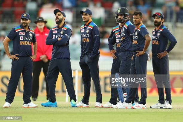 Virat Kohli of India reacts as he and his India team watch the replays on the big screen as the DRS review is undertaken during game three of the One...