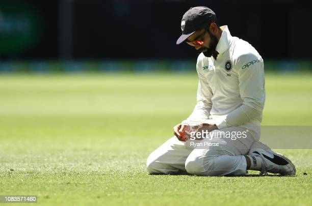 Virat Kohli of India reats during day four of the second match in the Test series between Australia and India at Perth Stadium on December 17 2018 in...