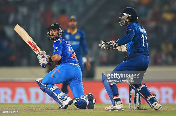 Virat Kohli of India reverse sweeps the ball towards the boundary as Kumar Sangakkara of Sri Lanka looks on during the ICC World Twenty20 Bangladesh...