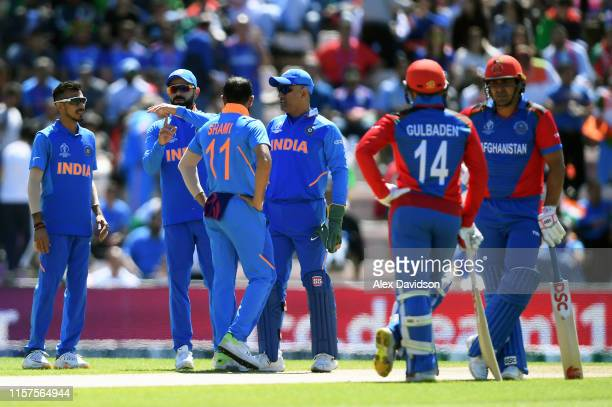 Virat Kohli of India reviews the wicket of Hazratullah Zazai of Afghanistan during the Group Stage match of the ICC Cricket World Cup 2019 between...