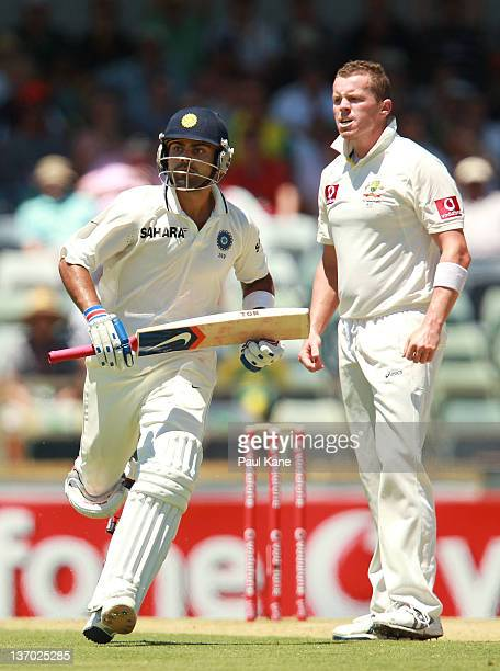 Virat Kohli of India runs past Peter Siddle of Australia during day three of the Third Test match between Australia and India at the WACA on January...