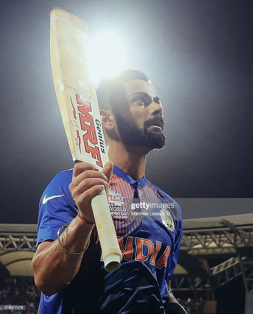 Virat Kohli of India salutes the crowd after his innings during the ICC World Twenty20 India 2016 Semi-Final match between West Indies and India at the Wankhede Stadium on March 31, 2016 in Mumbai, India.