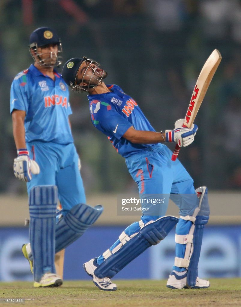 Virat Kohli of India screams after he hit the winning runs as MS Dhoni looks on as India win the ICC World Twenty20 Bangladesh 2014 2nd Semi-Final match between India and South Africa at Sher-e-Bangla Mirpur Stadium on April 4, 2014 in Dhaka, Bangladesh.