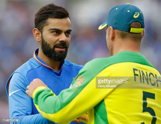 Virat Kohli of India shakes hands with Aaron Finch of Australia at the end of the Group Stage match of the ICC Cricket World Cup 2019 between India...