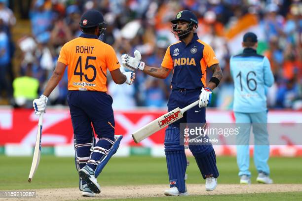 Virat Kohli of India shakes hands with Rohit Sharma after reaching his fifty during the Group Stage match of the ICC Cricket World Cup 2019 between...