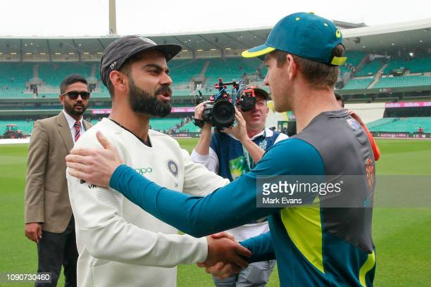 Virat Kohli of India shakes the hand of Australian Captain Tim Paine after India's 21 series win on day five of the Fourth Test match in the series...