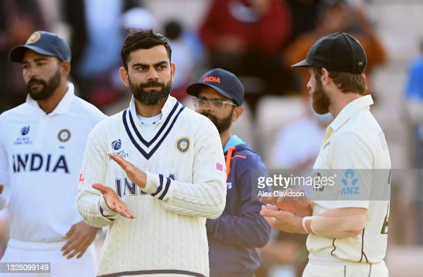 Virat Kohli of India speaks to Kane Williamson of New Zealand after the Reserve Day of the ICC World Test Championship Final between India and New...
