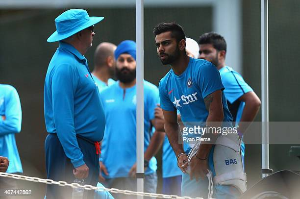 Virat Kohli of India speaks with Duncan Fletcher, coach of India, during the India nets session at Sydney Cricket Ground on March 25, 2015 in Sydney,...