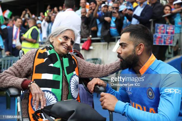 Virat Kohli of India speaks with Indian Fan Charu Lata Patel during the Group Stage match of the ICC Cricket World Cup 2019 between Bangladesh and...