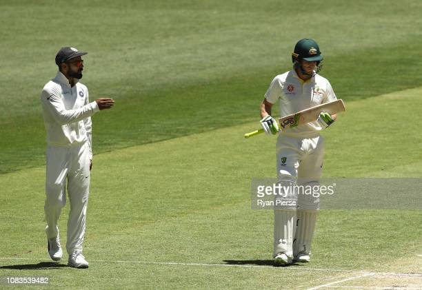 Virat Kohli of India speaks with Tim Paine of Australia during day four of the second match in the Test series between Australia and India at Perth...