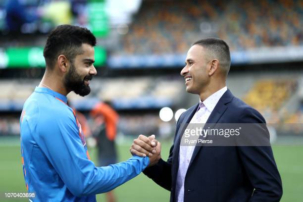 Virat Kohli of India speaks with Usman Khawaja of Australia during game one of the the International Twenty20 series between Australia and India at...