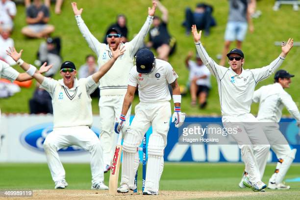 Virat Kohli of India stands his ground as Corey Anderson Brendon McCullum and Kane Williamson of New Zealand appeal unsuccessfully during day five of...