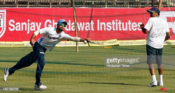 Virat Kohli of India takes a catch as Rohit Sharma looks on during the team practice session prior to the 4th One Day International match between...