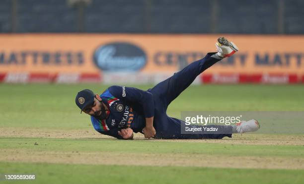 Virat Kohli of India takes a catch to dismiss Adil Rashid of England during the 3rd One Day International match between India and England at MCA...