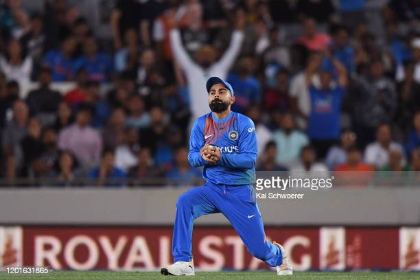 Virat Kohli of India takes a catch to dismiss Kane Williamson of New Zealand during game one of the Twenty20 series between New Zealand and India at...
