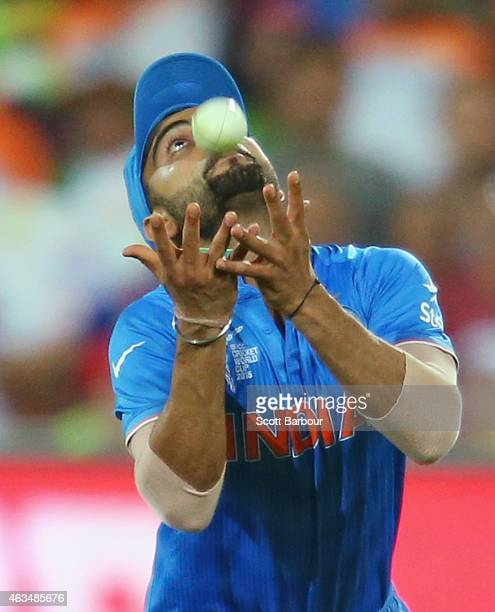 Virat Kohli of India takes a catch to dismiss Shahid Afridi of Pakistan during the 2015 ICC Cricket World Cup match between India and Pakistan at...