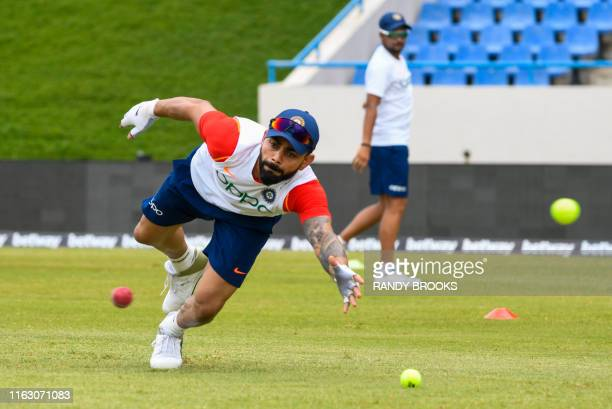 Virat Kohli of India takes part in a training session one day ahead of the 1st Test between West Indies and India at Vivian Richards Cricket Stadium,...
