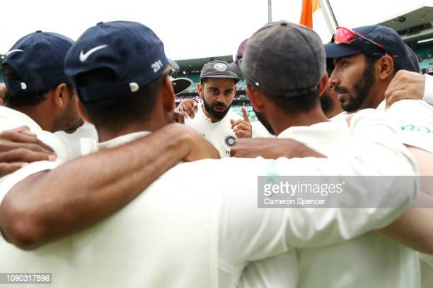 Virat Kohli of India talks to his players during day four of the Fourth Test match in the series between Australia and India at Sydney Cricket Ground...