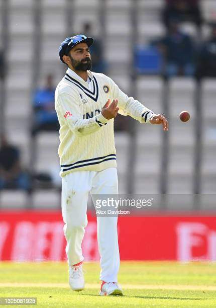 Virat Kohli of India throws the ball during the Reserve Day of the ICC World Test Championship Final between India and New Zealand at The Hampshire...
