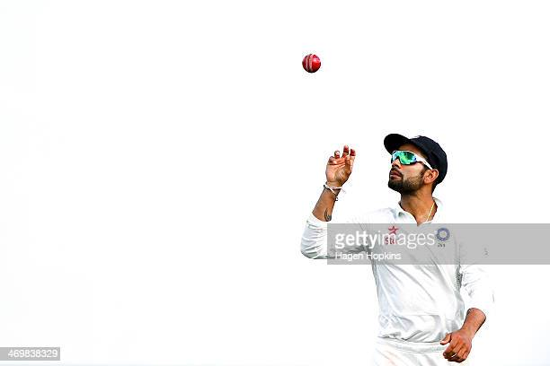 Virat Kohli of India throws the ball in the air at the end of an over during day four of the 2nd Test match between New Zealand and India on February...