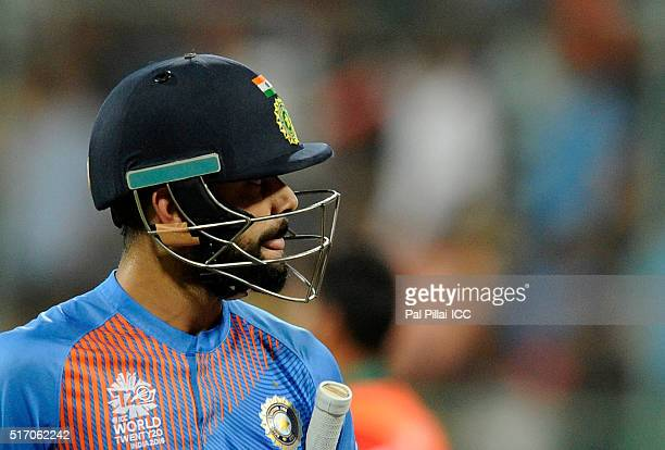 Virat Kohli of India walks back after getting out during the ICC World Twenty20 India 2016 match between India and Bangladesh at the Chinnaswamy...