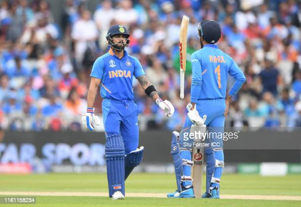 Virat Kohli of India walks off after being dismissed during the Semi-Final match of the ICC Cricket World Cup 2019 between India and New Zealand at...
