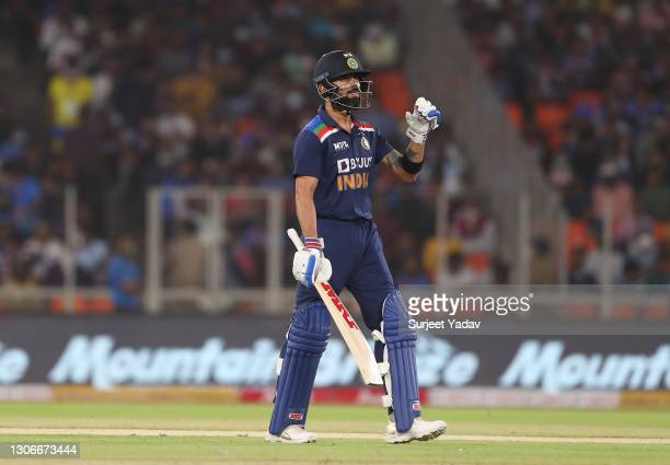 Virat Kohli of India walks off after being dismissed for 0 by Adil Rashid of England during the 1st T20 International match between India and England...