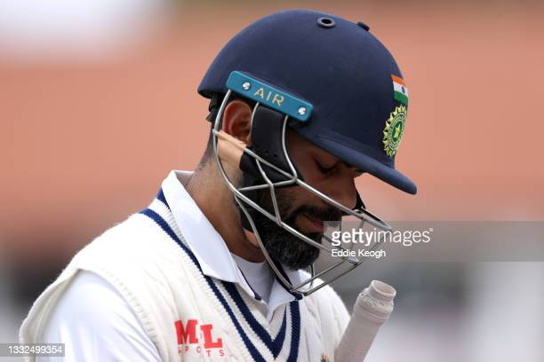Virat Kohli of India walks off after being dismissed for a duck off the bowling of James Anderson of England during day two of the First LV=...