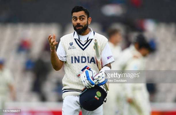 Virat Kohli of India walks off as bad light delays play on Day 2 of the ICC World Test Championship Final between India and New Zealand at The...